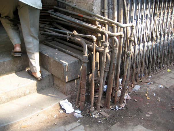 Photo of feet and pipes in Mumbai, India